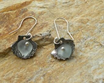 fine silver shell shaped earrings with genuine sea glass