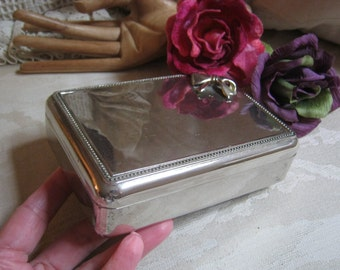 Vintage small heavy silver plate jewelry box, blue velvet lined rectangular silver jewel box, silver plate jewelry box with bow ornament
