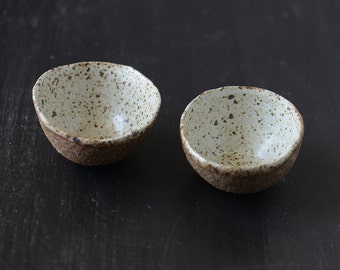 Hand built  small pair of nested Stoneware shallow bowls