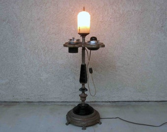 Vintage Art Deco Lighted Electric Smoking Stand. Cast Iron and Enamel. Circa 1930's.