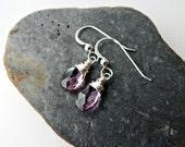 plum quartz. sterling silver. purple gemstone dangle. faceted, transparent gemstone. sterling silver ear hooks. simple drop earrings.