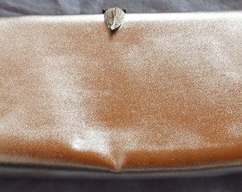 Shiny Silver Clutch Bag with Leaf Clasp