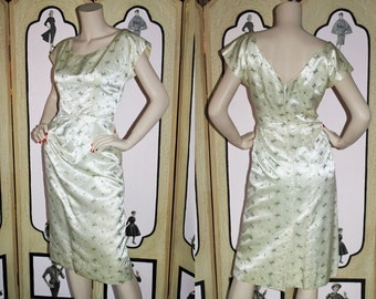 1950's Vintage Cocktail Dress in Cream Embroidered Satin with Asymmetric Waist and Hip Treatment. Small..