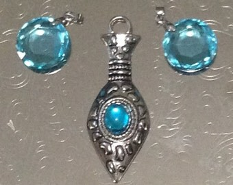 Silver pendant and blue charms