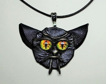 Leather Halloween necklace. Black leather pendant with dragon eye face. Gothic fashion pendant.  Goblin face pendant.