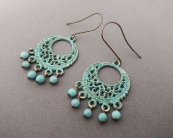 Turquoise Brass Earrings with exotic intricate design and dangling turquoise beads