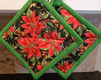 Red Christmas Poinsettas on Black with Green Trim Quilted Potholders or Hotpads Set