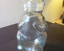 Teddy Bear Piggy Bank - 1938 Snow Crest Bottle Bank Salem Mass Glass Bank - great collectible - With lid - very fine condition
