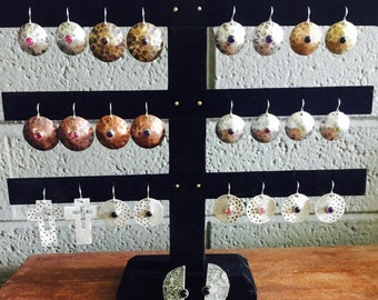 Hammered brass, copper or *silver earrings with small semi-precious gemstones in studio workshop in downtown phoenix