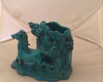 Vintage bakelite pencil cup sculpture running horse scene