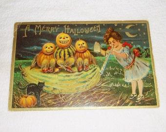 Antique A MERRY HALLOWEEN Postcard • girl . black cat. Jack O' Lantern