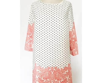 Black and white polka dot tunic dress with red print accent