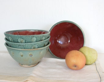 Four hand made stoneware bowls. Christmas colors, red green bowls, turquoise bowls, red bowls, wheel thrown, altered bowls, soup, cereal