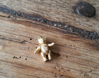 Metal teddy bear pendant with moving parts