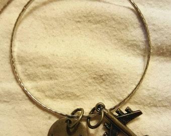 Bangle Bracelet with Airplane Travel Word Charm