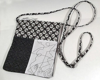 Black and white quilted bag with inside pocket