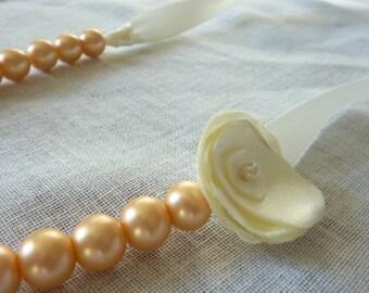 Big gold pearls finish ivory ribbon necklace