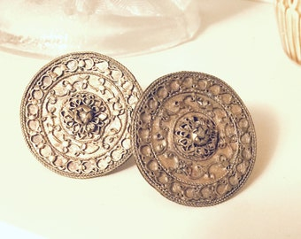 Hand crafted brass colored metal pieces filigree