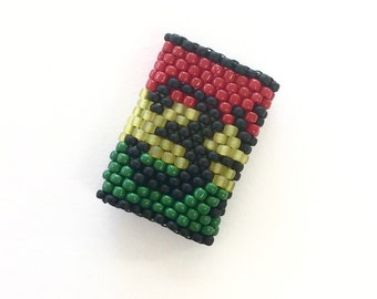 Rasta Color Dreadlock Beads - Om Symbol with Striped Red, Green and Gold Jamaican / Aftican colors