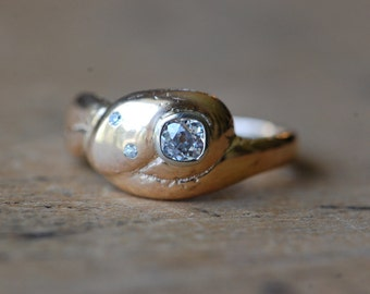 Vintage gold coiled snake ring with .33 carat Old European Cut diamond and diamond studded eyes