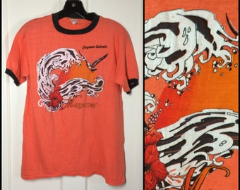 Vintage 1970's Orange Black Ringer Surfer Beach Cayman Island souvenir T-shirt large 19.5x24 all cotton Sunset Waves seagull flower colorful