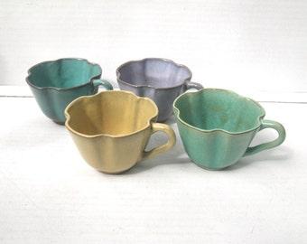 White Cloud Farms Pottery Teacups Set of Four Apple Mark Purple Aqua Gold Green