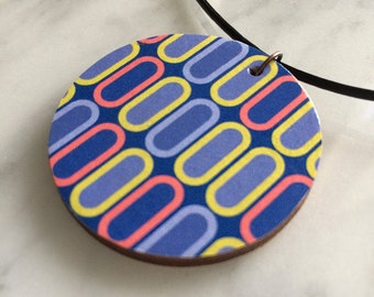 Wooden pendant, circular, geometric cellular pattern in blue, pale yellow & orange, fashion accessory, leather cord, style 53