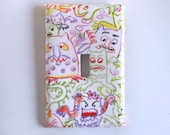 Funny Crayon Monsters Light Switch Plate in White with Bright Primary Colors