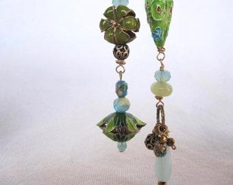 Asymmetrical cloisonne earrings in greens and blues