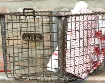 Antique wire locker bin with number