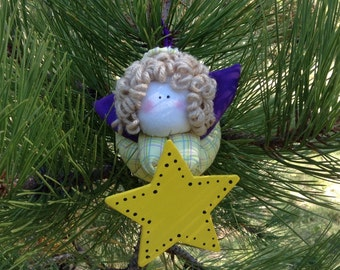 Primitive Blonde Angel with Yellow Plaid Body and Purple Wings holding  a Star Ornament