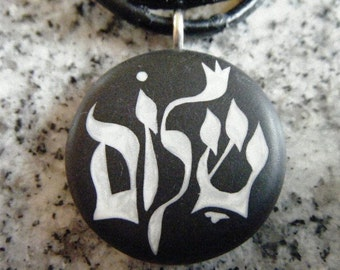 Hebrew  - Shalom - Peace Hand carved on a polymer clay black color background. Pendant comes with a FREE 3mm necklace