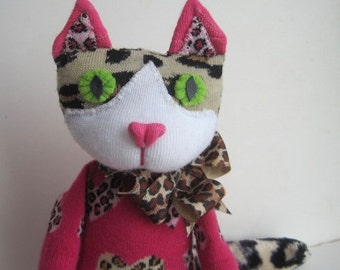 """SOLD! Introducing LOTTIE, an Ocelot sock toy just in time for Valentines Day. To quote Led Zepplin, Miss Lottie's """"gotta whole lotta love""""!"""