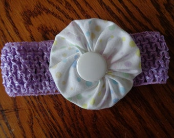 Infanct headband in purple with pastel dotted fabric flower with white button center