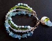 Multi Strand Gemstone Bracelet Aquamarine Peridot Moonstone And Larimar Stack Bracelet