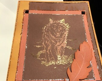 Card handmade Wolf feather in orange and brown tones