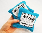 Travel pillow filled with soap bits