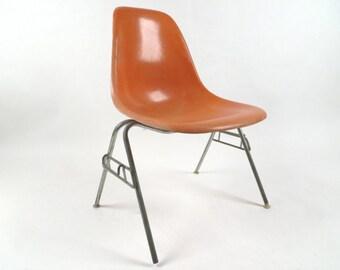 Herman Miller orange fiberglass side chair