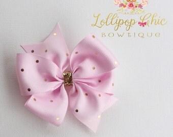 Light pink gold polkadot hair bow