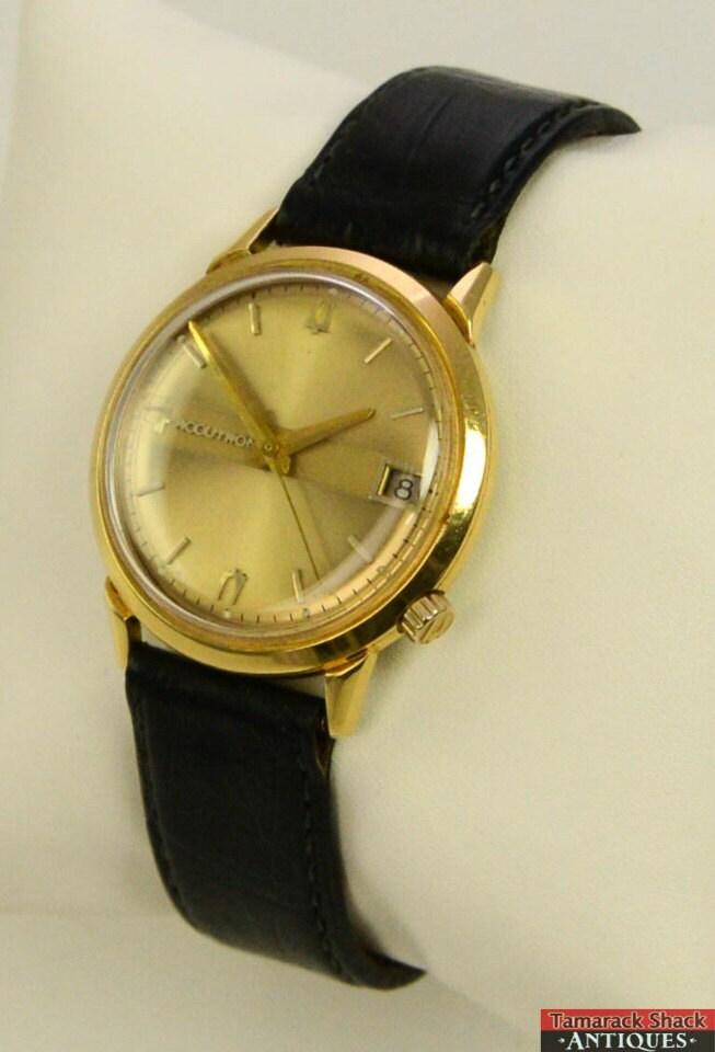 1965 bulova accutron 18k gold 218 keeps time wrist