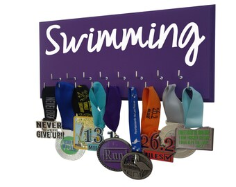 Swimming: Use a awards display rack to display your swimming awards
