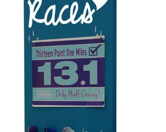 Running Races bib and medal holder - race bibs and running medals - Races heart logo in script letters.