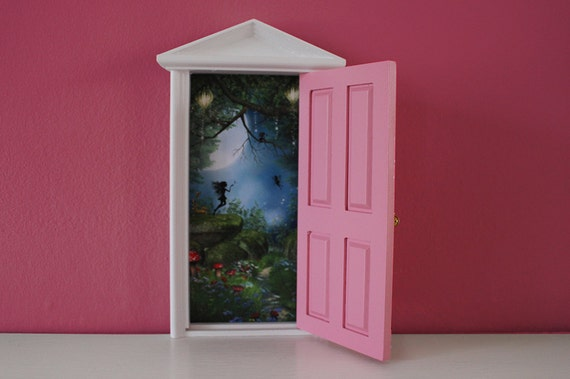 Pink tooth fairy door with tiny key and bottle of fairy dust for Fairy door with key