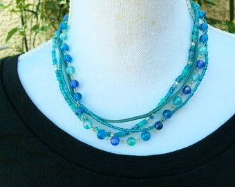 Necklace Light Blue Leather and Beads four strands with attitude: blue leather, blue glass beads, 17 - 19 inches