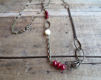 Vintage style bohemian necklace with small red beads and mixed antique brass chains