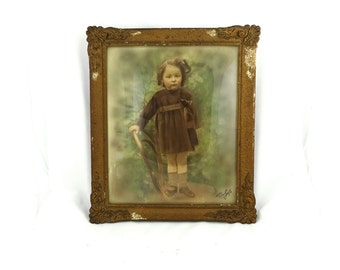 Antique 19th century sepia studio photograph portrait of little girl in gilt frame with convex glass.