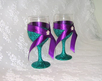 Wine Glasses or Toasting Flutes Glittered in Teal With Purple Ribbon and Crystal Accents, Peacock Wedding Colors