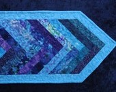 Jewel tone quilted table runner aquas and purples reversible