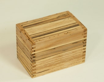 Recipe card file box crafted of spalted maple with many wormholes.