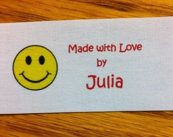 Sewing label  by buying 40 precut frayless  fabric sew in flat sewing labels with red nose smiley graphic